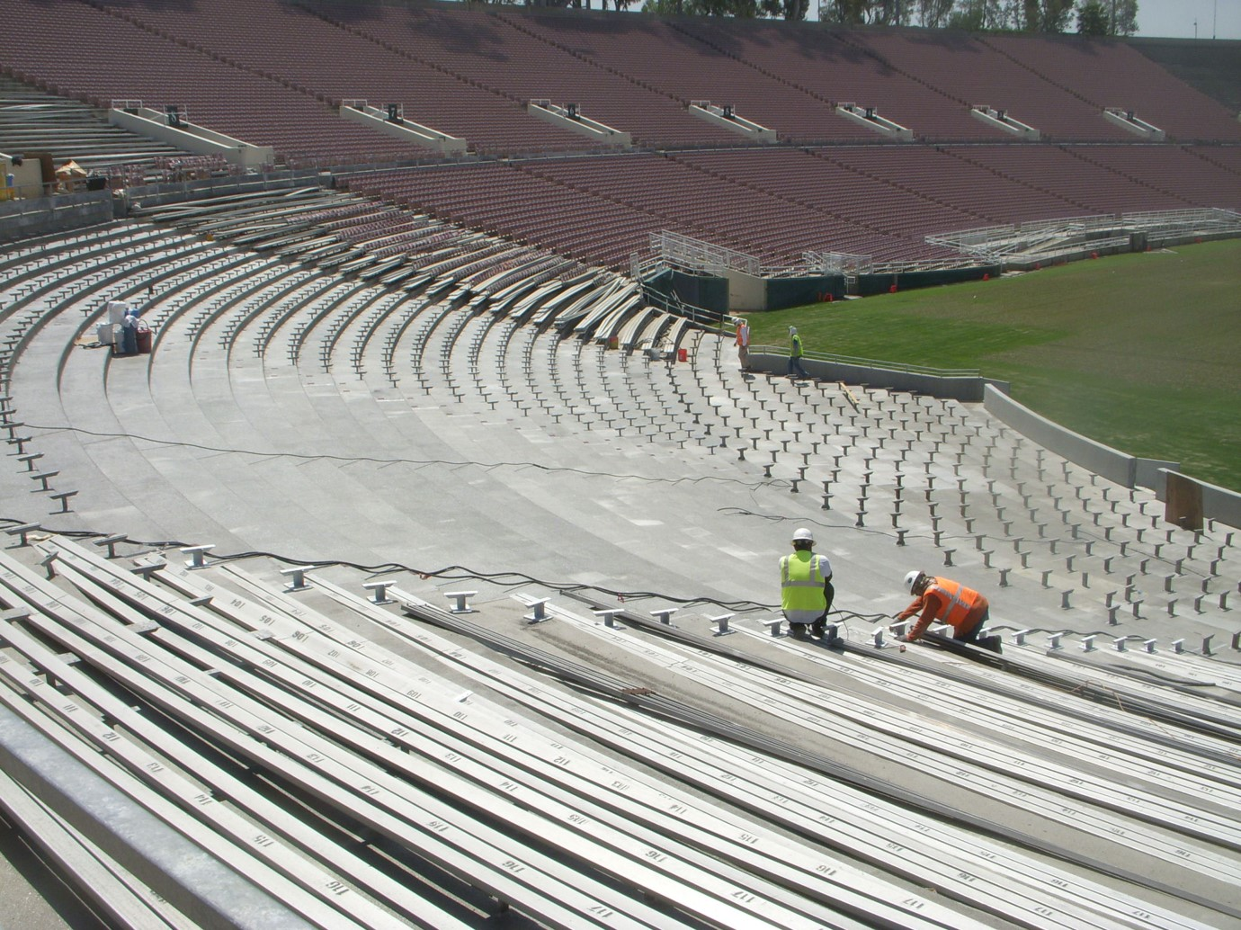 Reinstalling bowl seating on rehabilitated concrete risers by D'AIQ Architects
